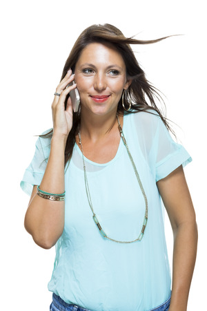 non verbal: On Portrait of Pretty Happy Woman in Casual Clothing Looking Something at her Mobile Phone Hand. Captures in studio with white background.