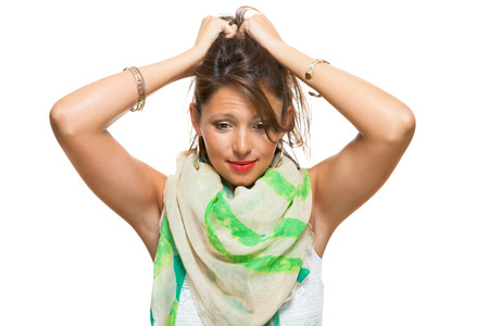 vivacious: Close up Laughing Pretty Woman with Scarf Around her Neck, Holding Back her Hair with Mouth Wide Open While Looking at the Camera. Isolated on White.