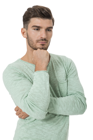 perturbed: Puzzled handsome young man scratching his head with his hand as he looks at the camera with an uncertain perturbed expression, isolated on white