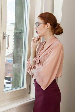 hesitating: Close up Serious Pretty Office Woman in Stylish Business Attire Looking Outside Through Glass Window