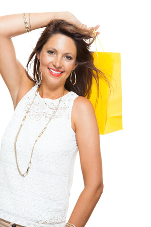 exuberant: Very Happy Stylish Woman Raising Three Colored Shopping Paper Bag with Mouth Open and Looking at the Camera. Isolated on White Background.
