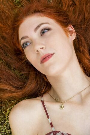 vivacious: Close up Very Happy Young Woman Lying on Grassy Ground Stock Photo