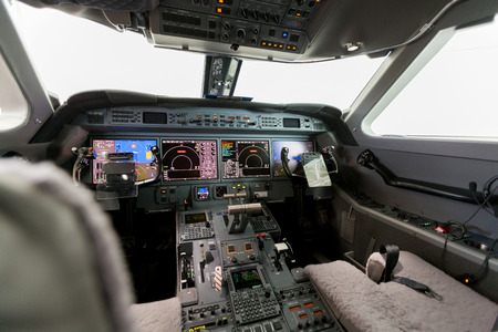 Inside view Cockpit G550 with blue sky and clouds