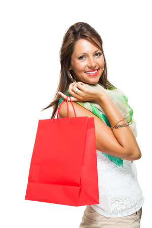 gleeful: Close up Smiling Fashionable Woman Looking Inside a Red Shopping Paper Bag. Isolated on White Background.