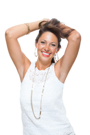 charismatic: Half Body Shot of a Smiling Attractive Woman in Trendy Outfit, Holding her Hair Up While Looking at the Camera. Isolated on White Background. Stock Photo