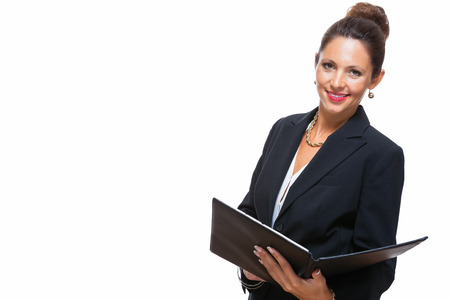 managerial: Portrait of an Attractive Young Businesswoman in Black Suit, Holding a File Folder and Smiling at the Camera. Isolated on White Background.