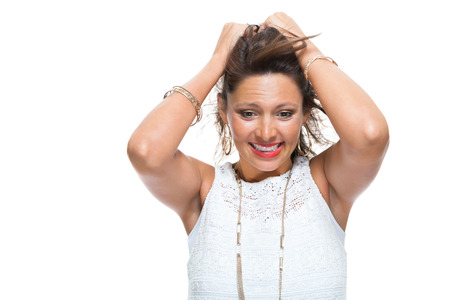 extrovert: Half Body Shot of a Smiling Attractive Woman in Trendy Outfit, Holding her Hair Up While Looking at the Camera. Isolated on White Background. Stock Photo
