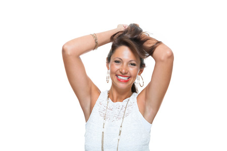 Half Body Shot of a Smiling Attractive Woman in Trendy Outfit, Holding her Hair Up While Looking at the Camera. Isolated on White Background. Reklamní fotografie