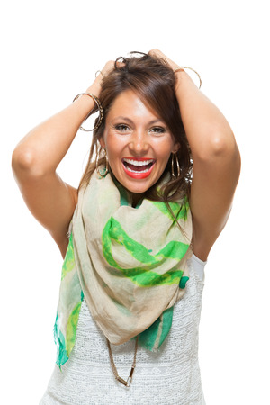 hilarity: Close up Laughing Pretty Woman with Scarf Around her Neck, Holding Back her Hair with Mouth Wide Open While Looking at the Camera. Isolated on White.