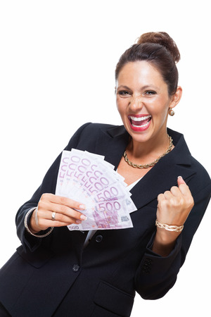 jubilation: Happy Successful Young Businesswoman Holding a Fan of 500 Euro Banknotes and Looking at the Camera, Isolated on White Background. Stock Photo