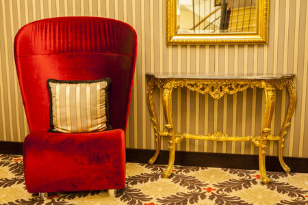 homestyle: Royal Armchair in red in warm athmosphere decoration homestyle living Stock Photo