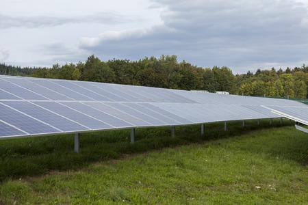 Field with blue siliciom solar cells alternative energy to collect sun energy