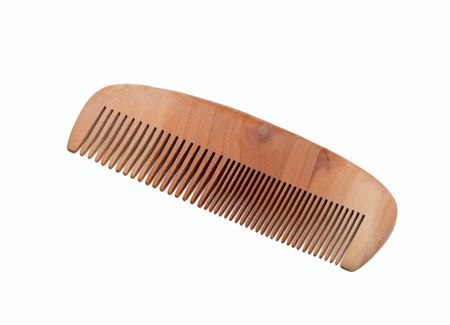 Wooden comb, isolated on white background photo