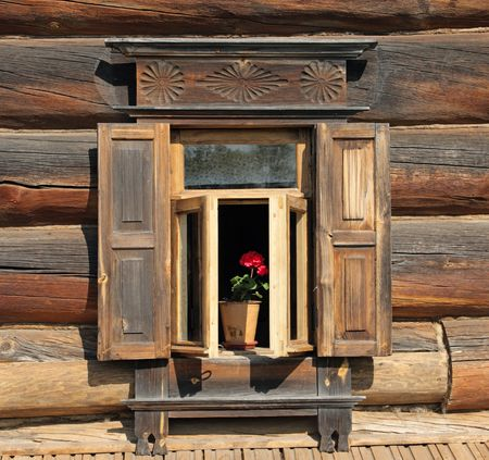 Ornamental window of the old rural house with flower. Suzdal, Gold Ring, Russia. Stock Photo