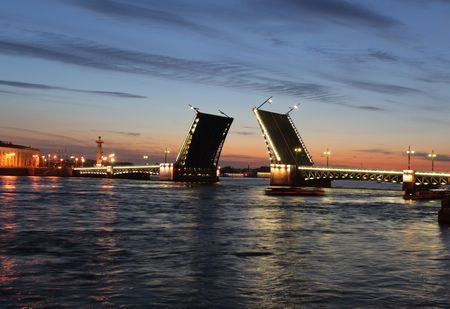 neva: Palace Bridge is a road traffic and foot bascule bridge spanning the Neva River in Saint Petersburg between Palace Square and Vasilievsky Island. St Petersburg, Russia. Stock Photo