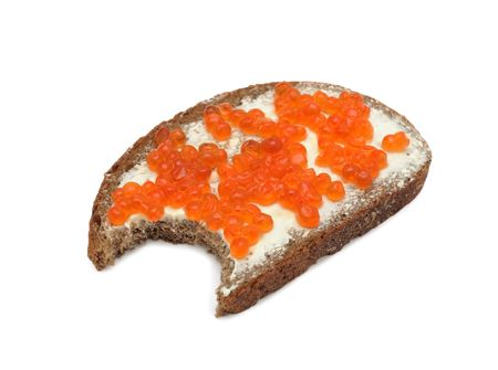 Sandwich with butter and salmon roe, isolated on a white background photo