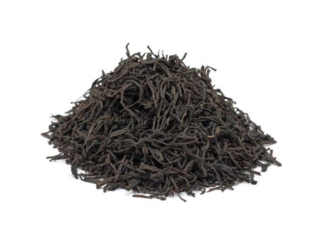 Pile of black tea, isolated on a white background photo