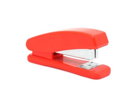 Red stapler, isolated on a white background photo