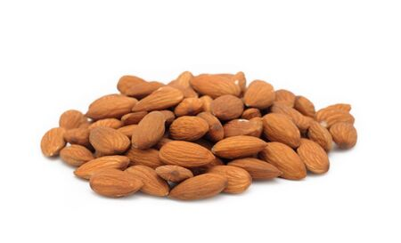 Pile of almonds, isolated on a white background photo