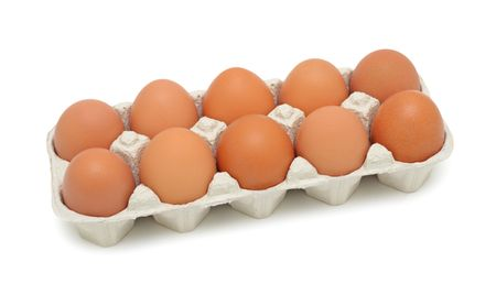 dozen: Fresh brown eggs in box, isolated on a white background