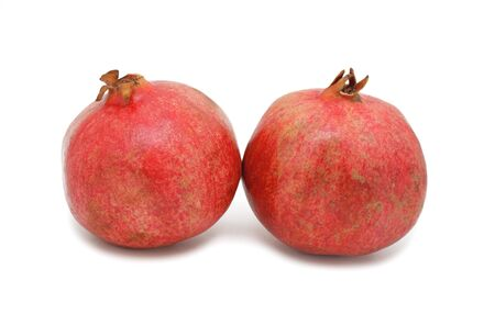 Red Pomegranates, isolated on a white background photo