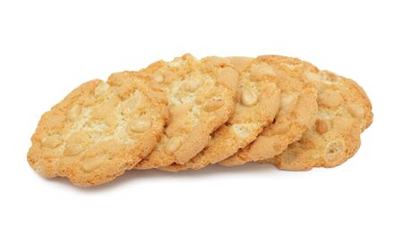 Pile of cookies stacked with nuts, isolated on a white background photo