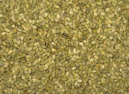 Close-up of shelled pumpkin seeds photo