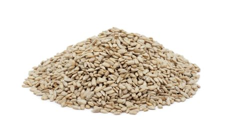 hulled: Pile of shelled sunflower seeds, isolated on a white background Stock Photo