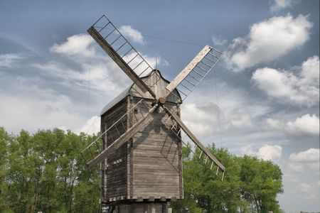 traditional windmill: An old traditional windmill with wooden sails