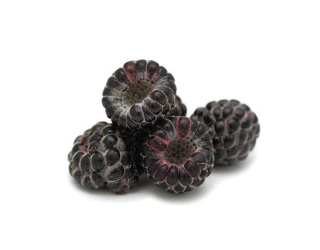 Pile of black raspberries, isolated on a white background