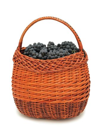 Fresh grapes in a basket, isolated on a white background photo