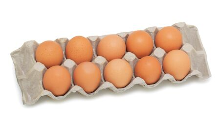 Fresh brown eggs in box, isolated on a white background photo