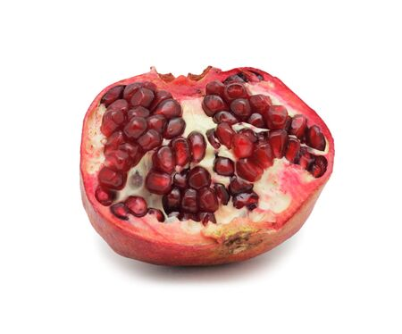 Red pomegranate, isolated on a white background photo