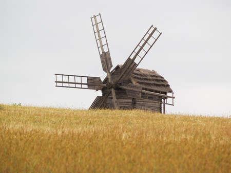 Old village windmill on the field photo