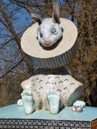 Statue of rabbit decored with mosaic from fairy tale Editorial