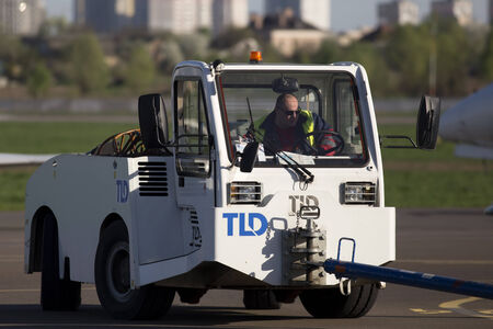 Kiev, Ukraine - April 25, 2014  White pushback tractor in the Kiev International Airport on April 25, 2014  Editorial use only