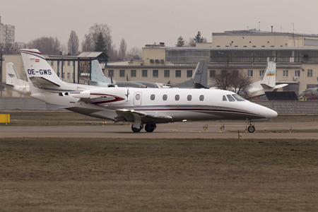 excel: Kiev, Ukraine - March 15, 2015: Cessna 560XLS Citation Excel business aircraft preparing for take-off from the runway of Kiev International Airport on March 15, 2015. Editorial use only