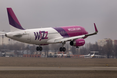 aircraft landing: Kiev, Ukraine - March 15, 2015: Wizz Air Airbus A320-232 aircraft landing on the runway of the Kiev International Airport on March 15, 2015. Editorial use only Editorial