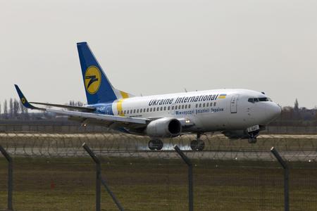 interceptor: Borispol, Ukraine - March 25, 2017: Ukraine International Airlines Boeing 737-500 aircraft landing on the runway to Borispol International Airport on March 25, 2017. Editorial use only Editorial
