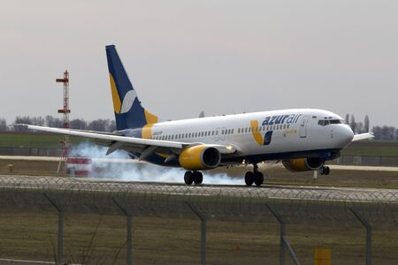 get away: Borispol, Ukraine - March 25, 2017: Azur Air Ukraine Boeing 737-800 aircraft landing on the runway to Borispol International Airport on March 25, 2017. Editorial use only