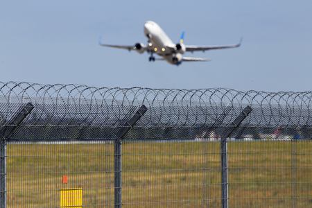 Departing aircraft on the blue sky background