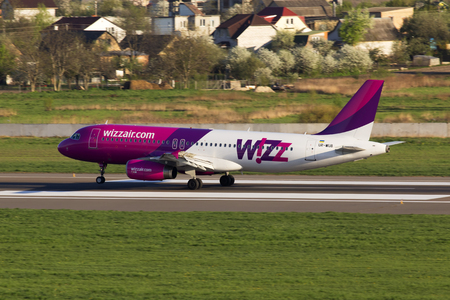Kiev, Ukraine - April 25, 2014: UR-WUB Wizz Air Airbus A320 aircraft landing on the runway of Kiev International Airport. Editorial use only