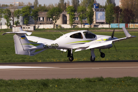 Kiev, Ukraine - April 25, 2014: Diamond DA42 Twin Star business aircraft landing on the runway of Kiev International Airport. Editorial use only