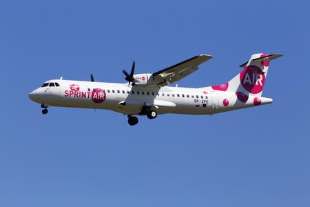 Borispol, Ukraine - May 26, 2018: SP-SPE SprintAir ATR 72 aircraft on the blue sky background