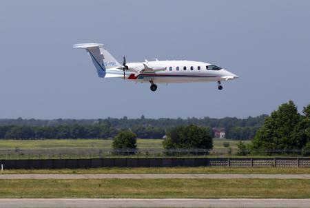 Borispol, Ukraine - May 26, 2018: ES-PAL Piaggio P-180 Avanti Evo business jet aircraft landing on the runway of Borispol International Airport Editorial