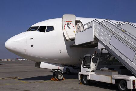 White modern aircraft on the parking zone awaiting service maintenance 版權商用圖片
