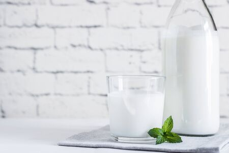 Organic probiotic milk kefir drink or yogurt in glass containers,on the white grey background. Gut health. Probiotic cold fermented dairy drink. Trendy food and drink. Copy space Stok Fotoğraf