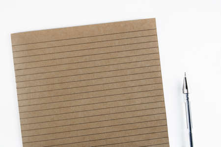 Notebook sheet in a ruler. School notebook. Lines. Brown paper. Close-up notepad sheet. Secondary use. Copy space
