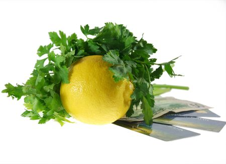 verdure: the lemon with the verdure rests upon  the money