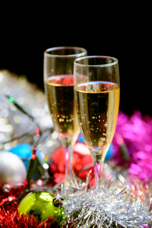 Cristmas: Cristmas glasses filled with champagne on cristmas decoration background